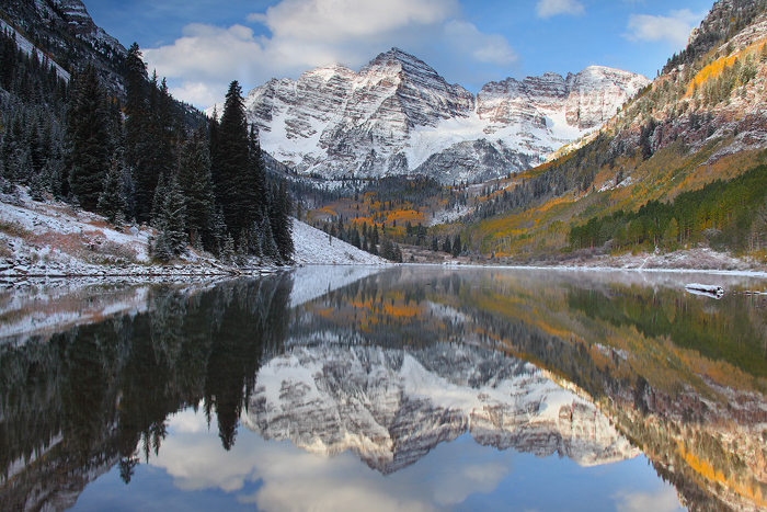 The awe inspiring twin peaks of the Maroon Bells are mirrored in a high alpine lake on a perfect late september morning. The...
