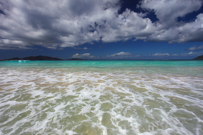 Standing ankle deep in the pristine waters of the Caribbean Sea, looking out at otherworldly colors of the ocean, there is no...