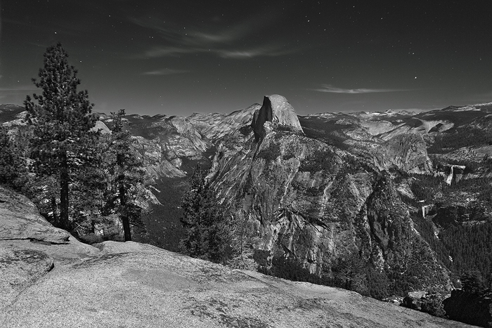 The light of a full moon illuminates the magnificent Yosemite Valley, and its most famous icon, Half Dome. Standing here on Glacier...
