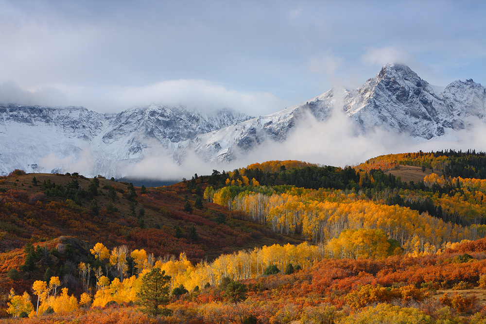 An overnight storm which left the high mountain peaks of the sneffels range covered in a fresh layer of snow burns off in the...