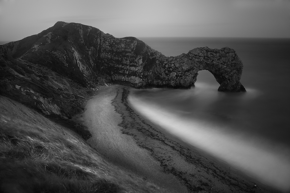 The magnificent limestone arch of Durdle Door on the southern coast of England as seen on an amazingly windy and stormy day....