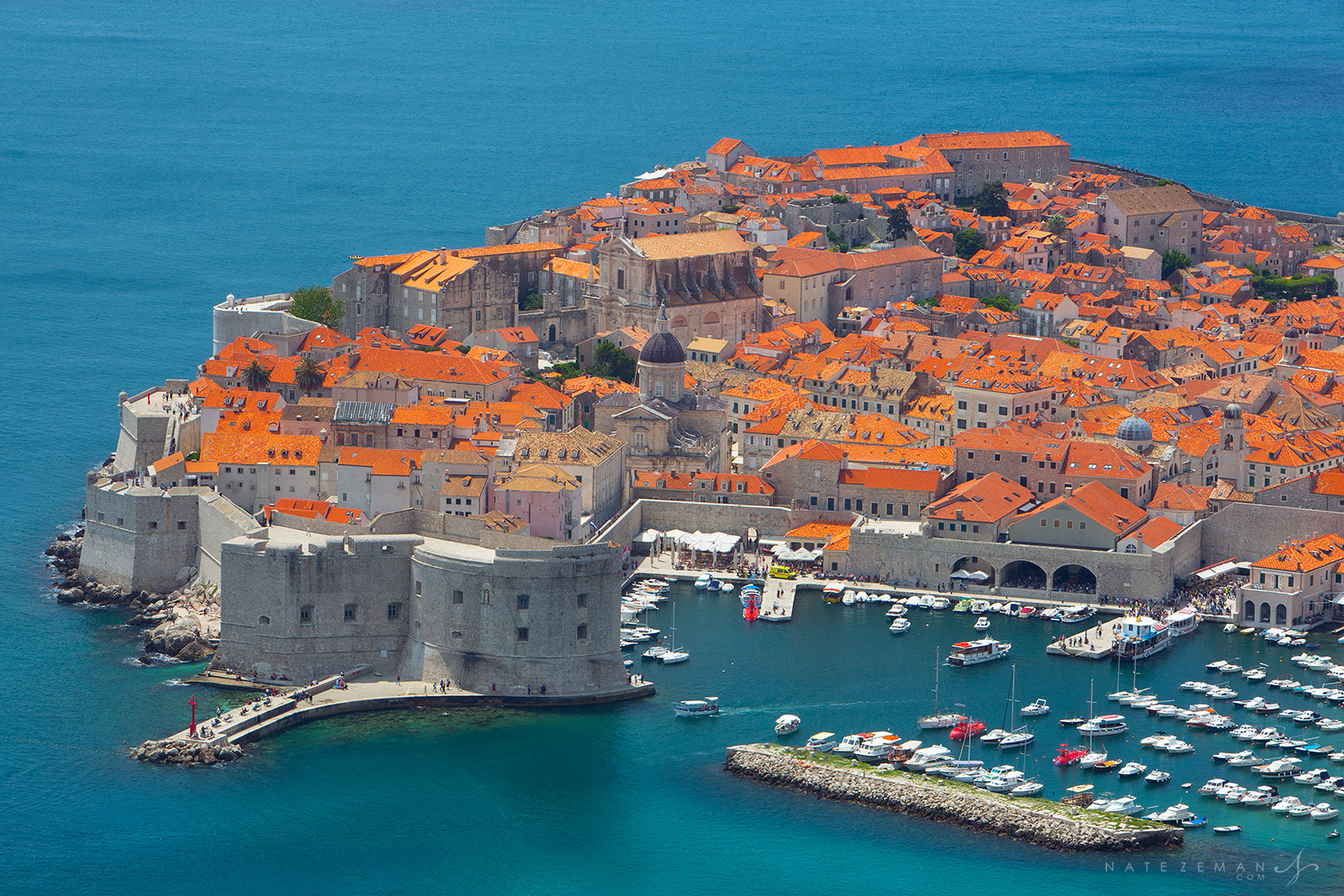 The Dalmatian Coast is dotted with beautiful cities and villages whose red roofed buildings are met by the crystal blue waters...