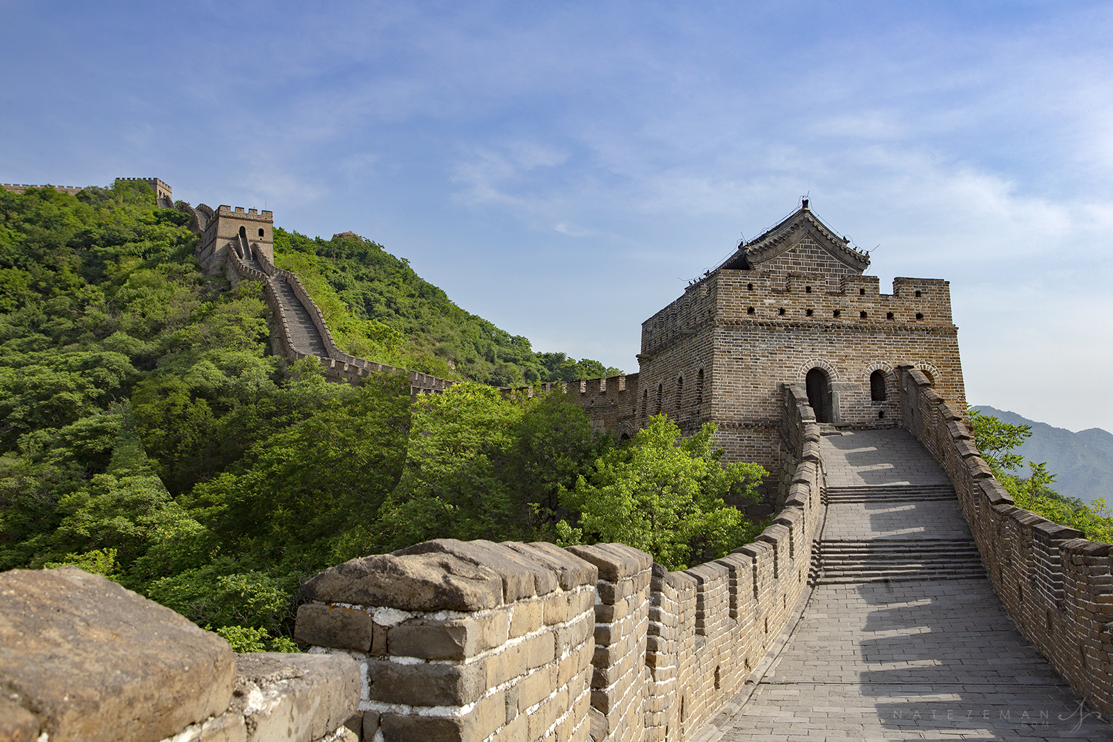 The Mutianyu Great Wall was originally built by the Northern Qi Dynasty in (550–577) over 1,400 years ago. It was rebuilt and...